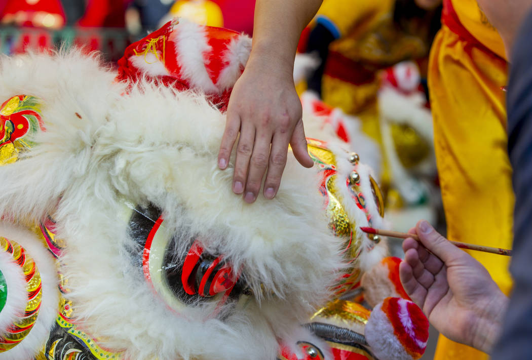 Eyes are painted on the lions as performers with the Yau Kung Moon dance troupe from San Franci ...