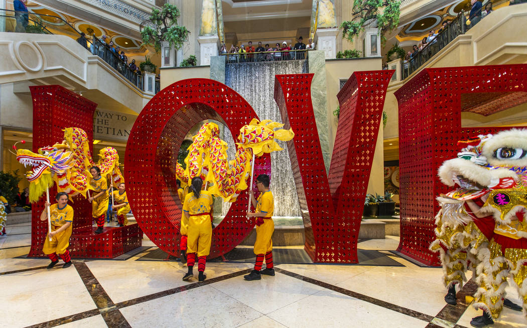 Performers with Yau Kung Moon dance troupe from San Francisco weave within the LOVE sculpture t ...