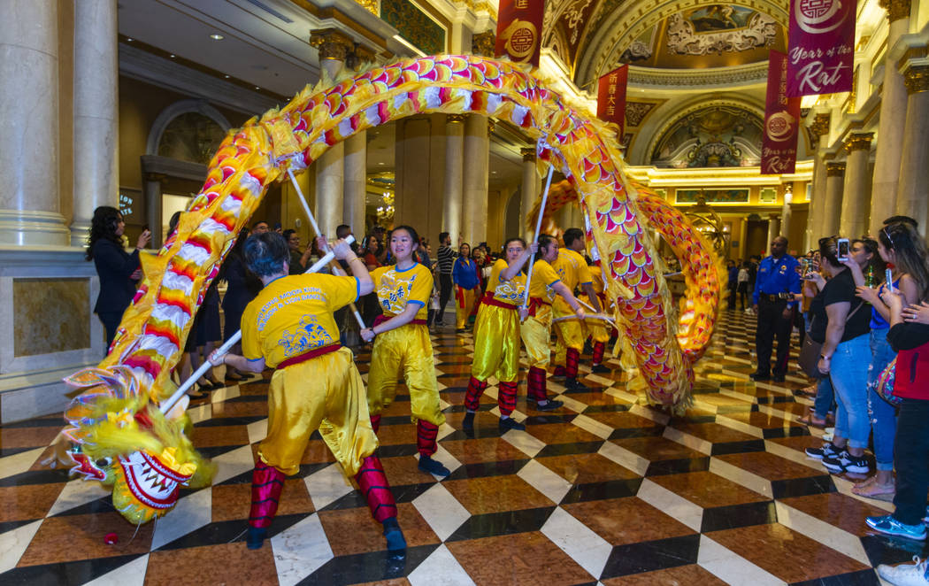 Dancers from the Yau Kung Moon dance troupe in San Francisco perform a dragon dance through the ...