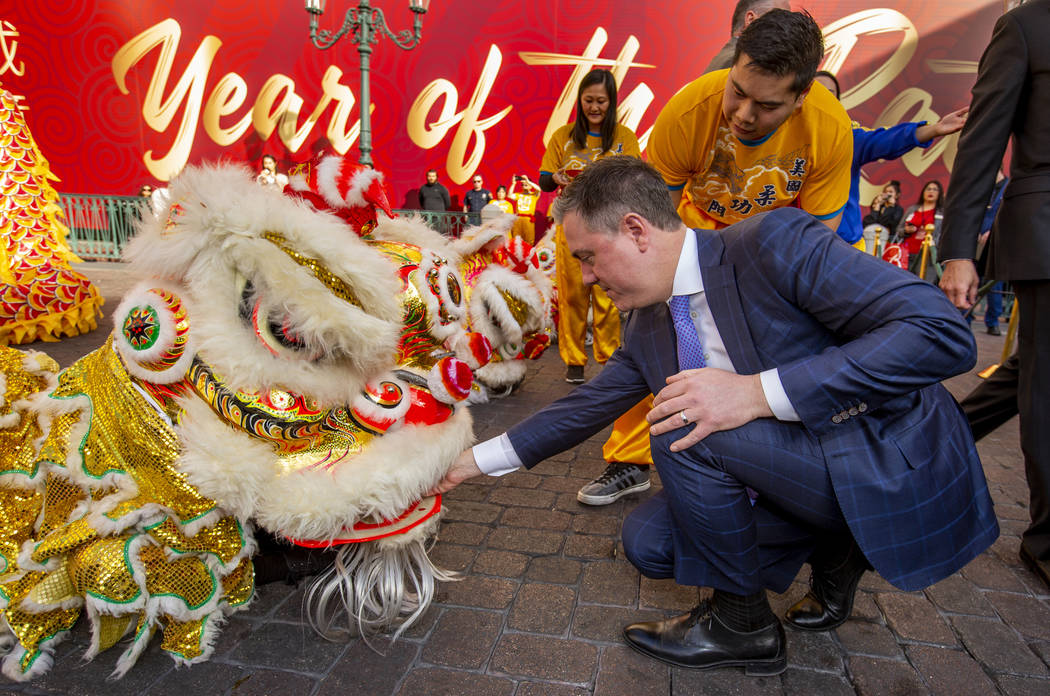 Michael Volkert, senior vice president of casino operations at The Venetian, places an envelope ...