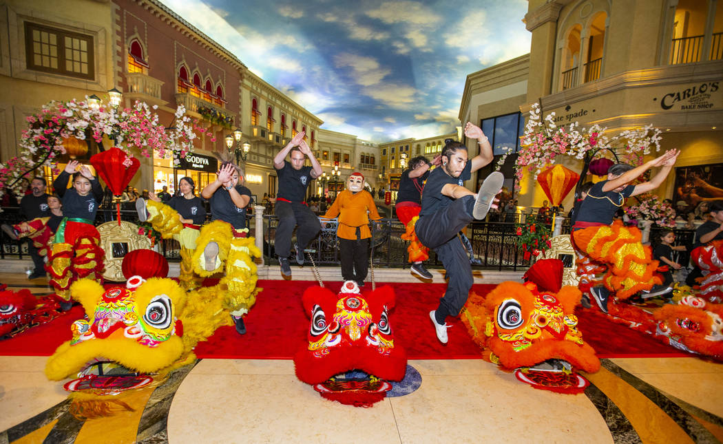 Members of the Lohan School of Shaolin warm up for a lion dance as the Grand Canal Shoppes cele ...
