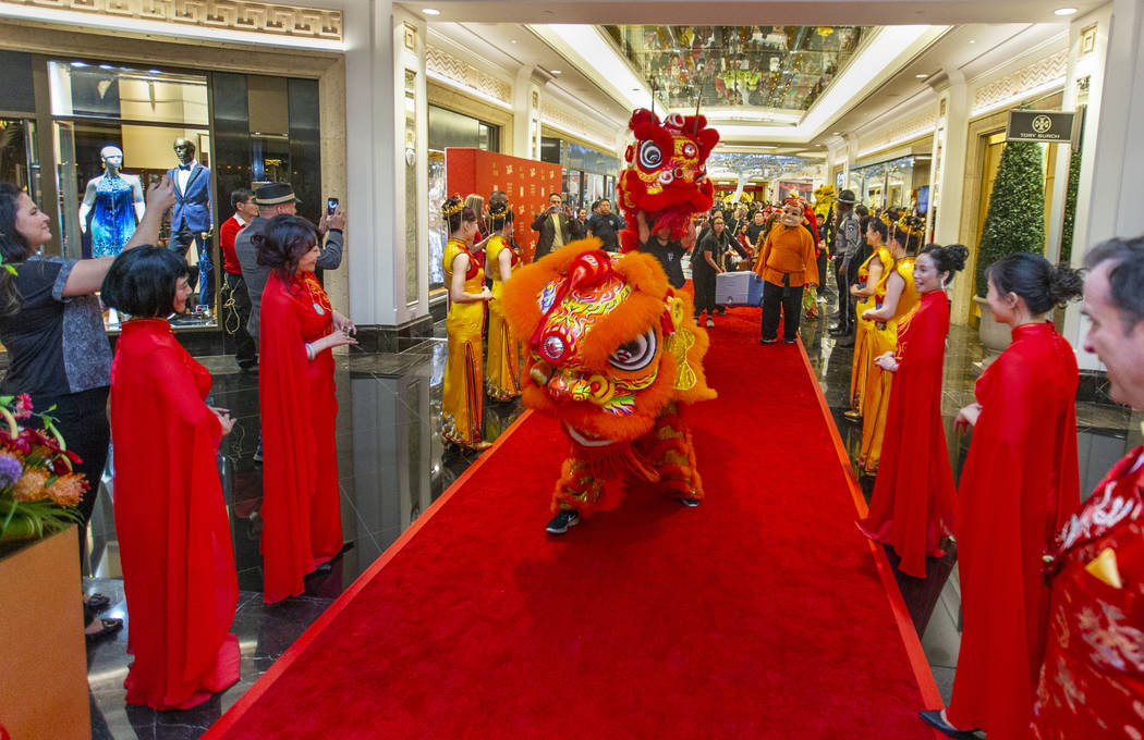 The Lohan School of Shaolin conduct a lion dance into a reception as the Grand Canal Shoppes ce ...