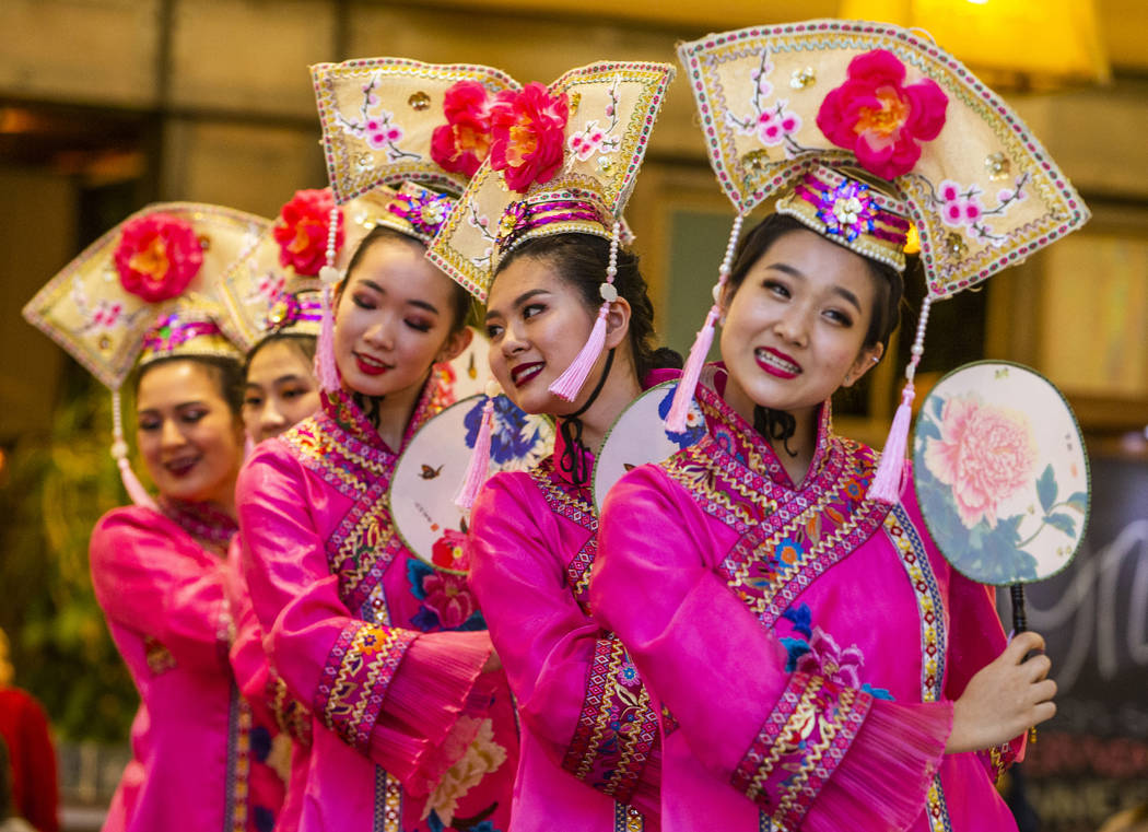 Members of the Shirley Chen dance troupe perform at a reception as the Grand Canal Shoppes cele ...