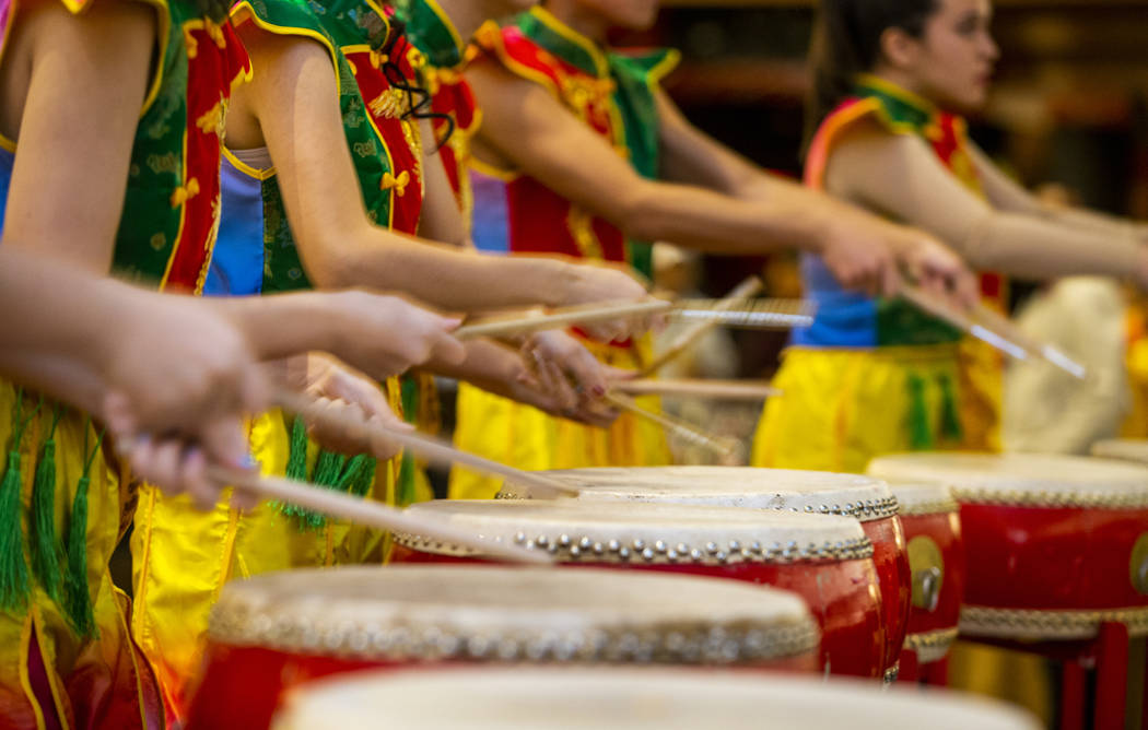 Members of the Li Ling Hong drum group perform at a reception as the Grand Canal Shoppes celebr ...
