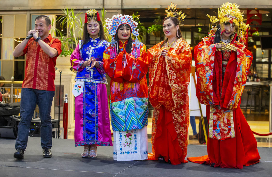 Performer Jee Wong, left, sings a traditional song amongst models in various Chinese dynasty dr ...