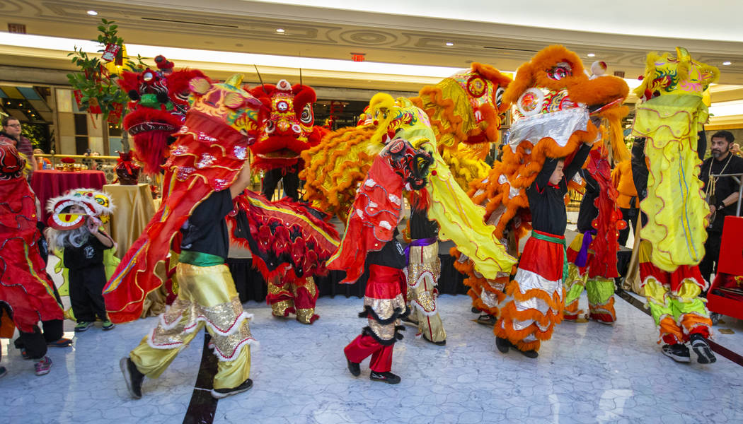The Lohan School of Shaolin conduct a lion dance at a reception as the Grand Canal Shoppes cele ...