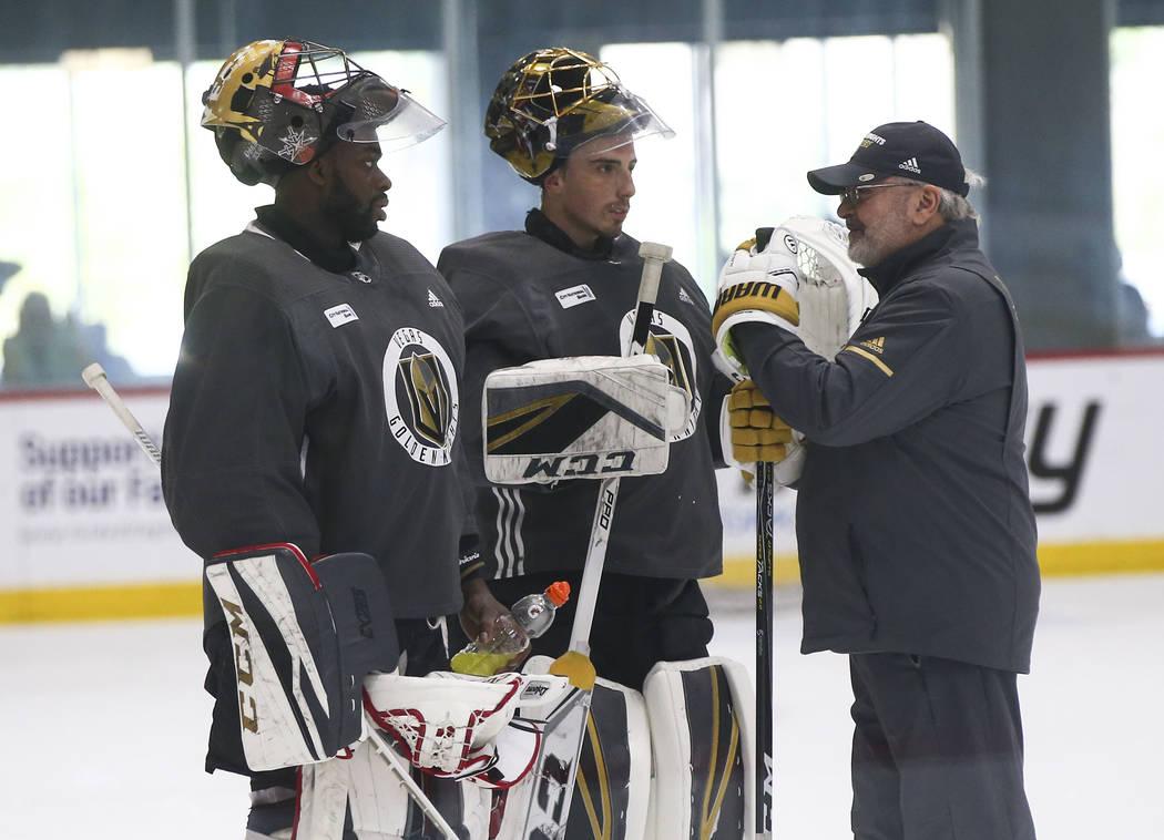 Golden Knights goaltending coach David Prior, right, talks with goaltenders Malcolm Subban, lef ...