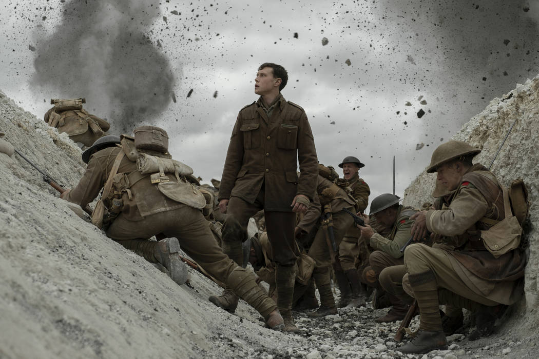 """This image released by Universal Pictures shows George MacKay, center, in a scene from """"19 ..."""