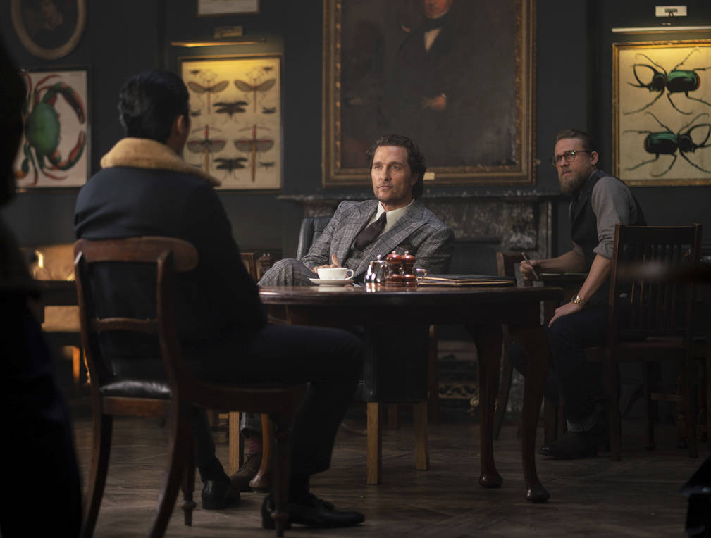This image released by STXfilms shows, from left, Henry Golding, Matthew McConaughey and Charli ...