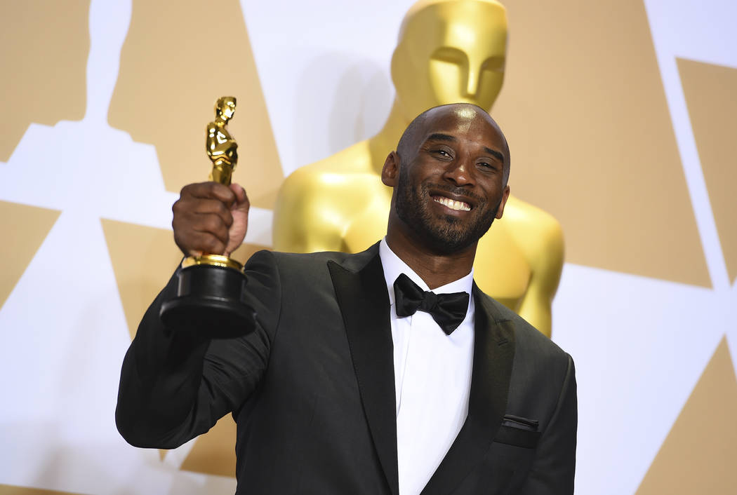 FILE - This March 4, 2018 file photo shows Kobe Bryant, winner of the award for best animated s ...