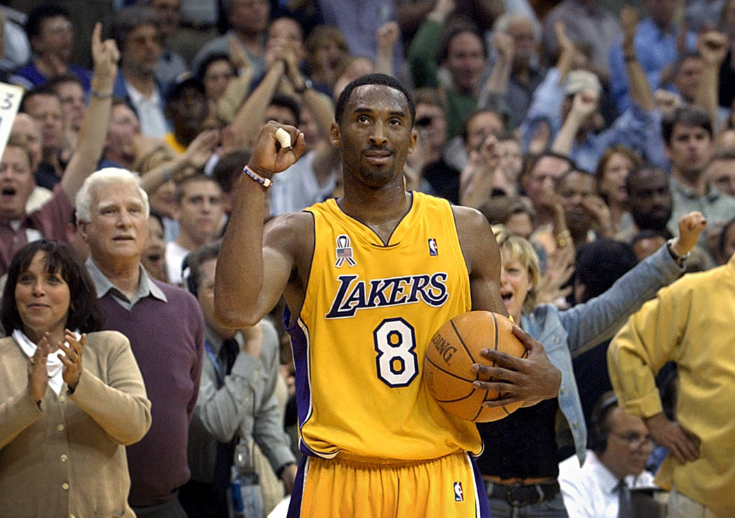 FILE - In this May 14, 2002 file photo Los Angeles Lakers guard Kobe Bryant watches the clock r ...