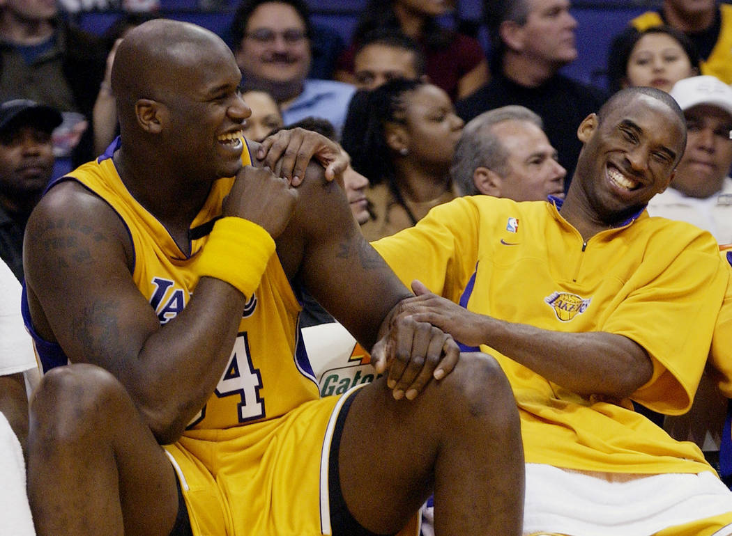 FILE - In this April 15, 2003, file photo, Los Angeles Lakers Shaquille O'Neal, left, and Kobe ...