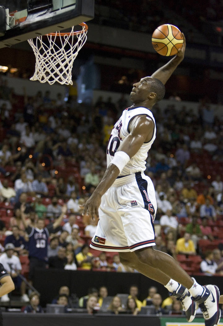 Los Angeles Lakers guard Kobe Bryant dunks in the first half of Team USA's 113-63 victory over ...