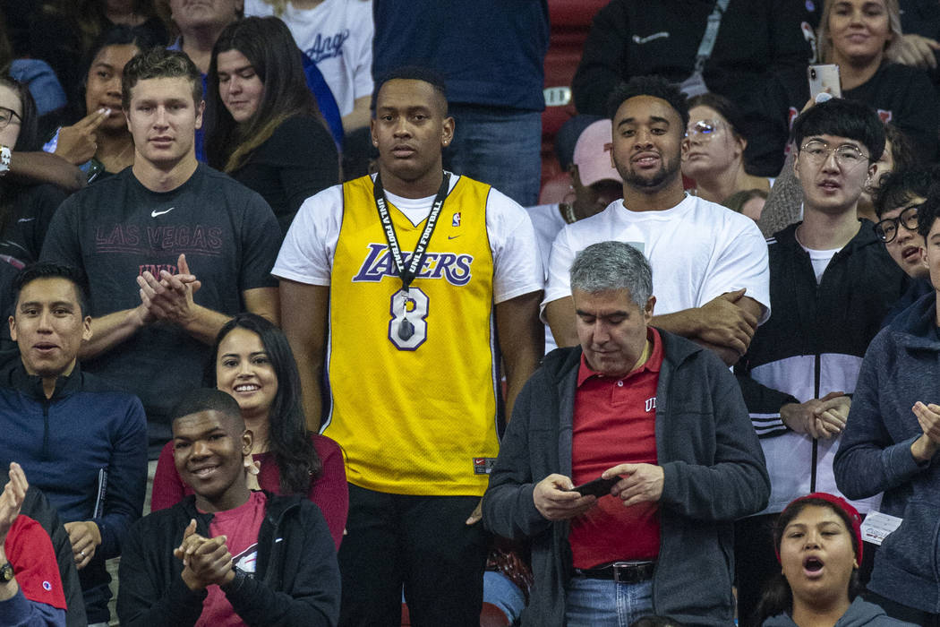 A fan wears a Kobe Bryant Lakers' jersey as he watches the UNLV Rebels battle the San Diego Sta ...