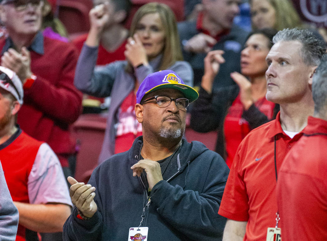 A UNLV Rebels fan wears a Lakers' hat as they take on the San Diego State Aztecs during the sec ...
