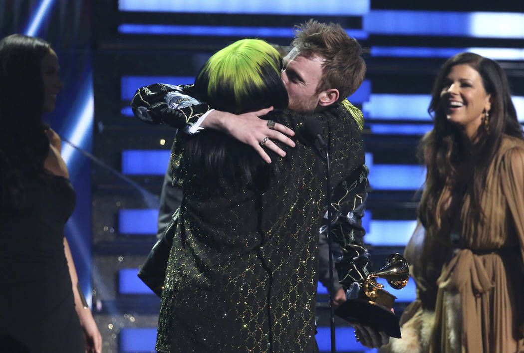 Billie Eilish, left, and Finneas O'Connell embrace after accepting the award for song of the ye ...
