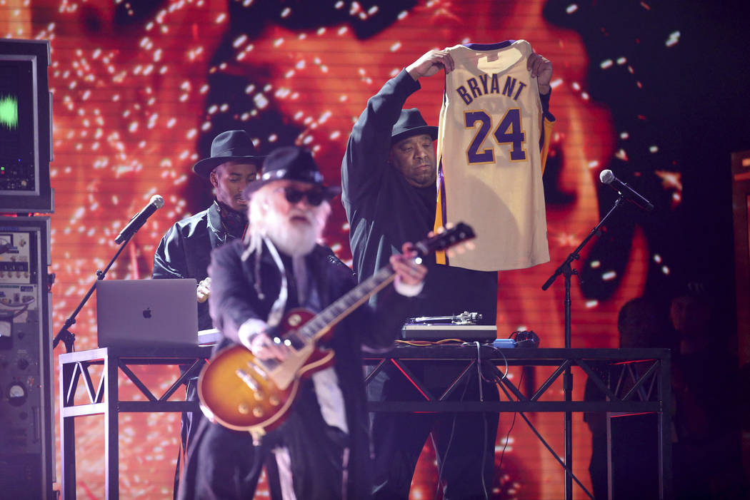 Joseph Simmons holds a jersey of the late Kobe Bryant at the 62nd annual Grammy Awards on Sunda ...