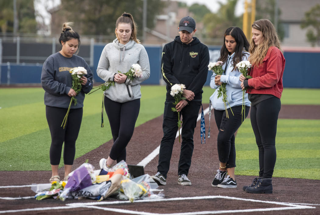 Orange Coast College students and friends of baseball coach John Altobelli lay flowers at home ...