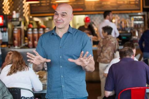 "Michael Symon in ""Burgers, Brew & 'Que"" (Michael Blair/Food Network)"
