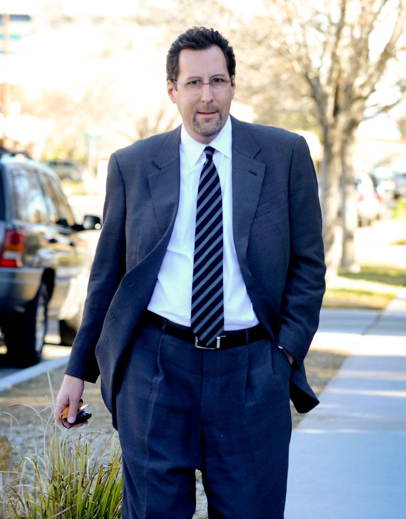 Developer Chris Milam arrives at a law office in Las Vegas to give a sworn statement on Feb. 22 ...