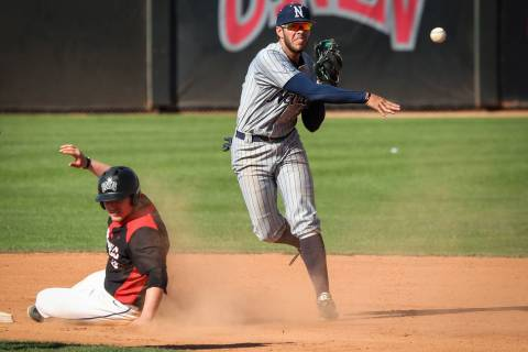 Jack-Thomas Wold, shown sliding last season, went 2-for-5 with a double for UNLV in its season- ...