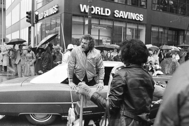 Big John Matuszak of the Super Bowl champion Raiders shouts at fans from his limousine during ...