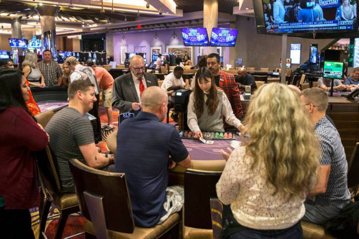 Gambers play blackjack at SLS Las Vegas on Thursday, May, 30, 2019, in Las Vegas. (Benjamin Hag ...