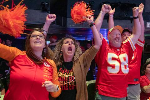 Kansas City Chiefs' fans Amy Teschner, left, Ashli Hanlan, center, and Mike Hanlen, of Kansas C ...