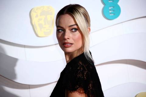 Margot Robbie poses for photographers upon arrival at the Bafta Film Awards, in central London, ...