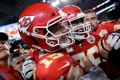 Kansas City Chiefs quarterback Patrick Mahomes (15) celebrates after the NFL Super Bowl 54 foot ...