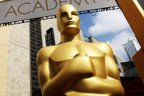 FILE - In this Feb. 21, 2015 file photo, an Oscar statue appears outside the Dolby Theatre for ...