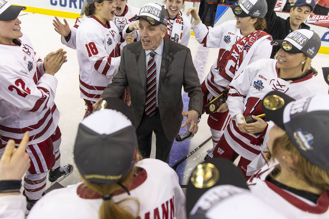 Wisconsin head coach Mark Johnson, center, celebrates with his players after the University of ...
