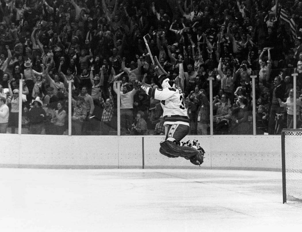 FILE -In this Feb. 22, 1980 file photo, U.S. Goalie James Craig leaps high in the air at the fi ...