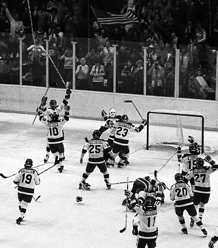 FILE - In this Feb. 22, 1980, file photo, The United States ice hockey team rushes toward goali ...