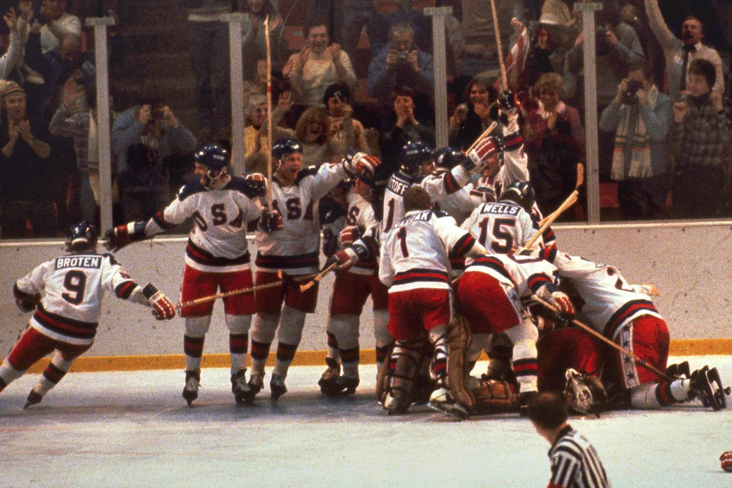FILE -In this Feb. 22, 1980 file photo, the U.S. hockey team pounces on goalie Jim Craig after ...