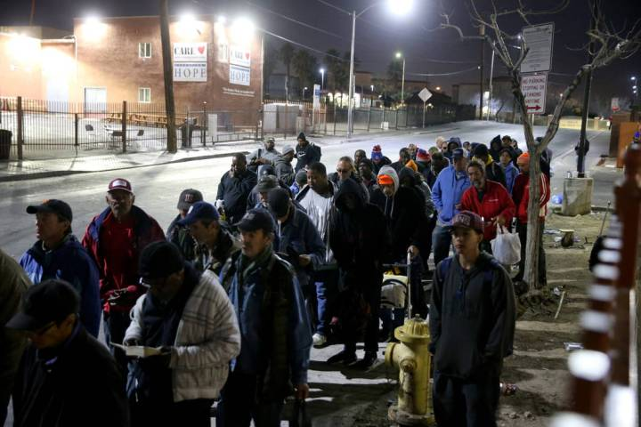 People line up for the overnight shelter beds at Catholic Charities in Las Vegas Thursday, Feb. ...
