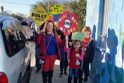 Parent Shuuanndy Alvarez, left, at a rally at Walter Bracken STEAM Academy on Friday, Feb. 7, 2 ...