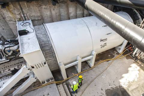 Media get a first glimpse at a tunnel boring machine at the future location of one of the under ...