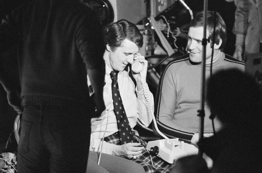 Herb Brooks receives a phone call from President Carter in Lake Placid, New York Friday, Feb. ...