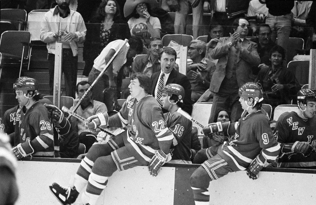 New York Rangers coach Herb Brooks yells at the buzzer as his team leaps off the bench with a 4 ...