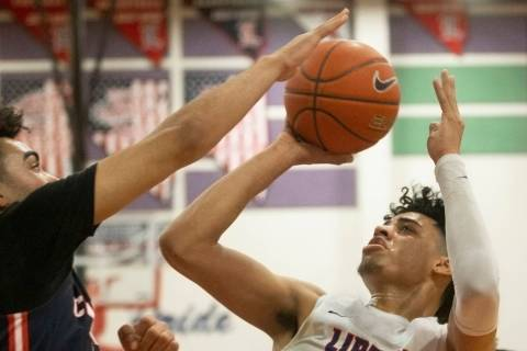 Liberty senior guard Julian Strawther (0) shoots over Coronado senior guard Dallas Rider (3) in ...