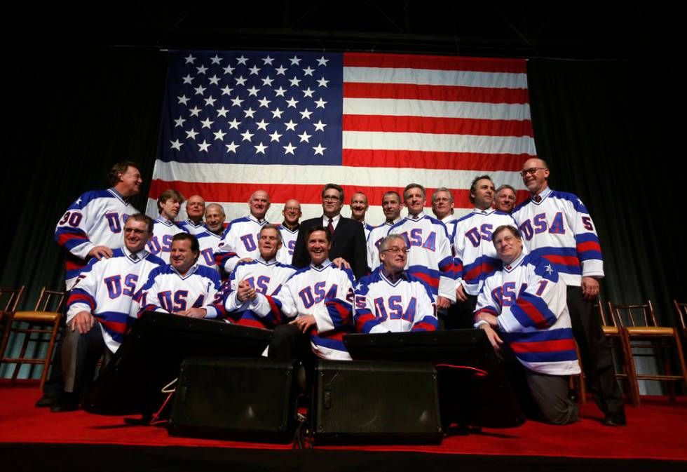"Members of the 1980 U.S. ice hockey team pose for photos after a ""Relive the Miracle"" ..."