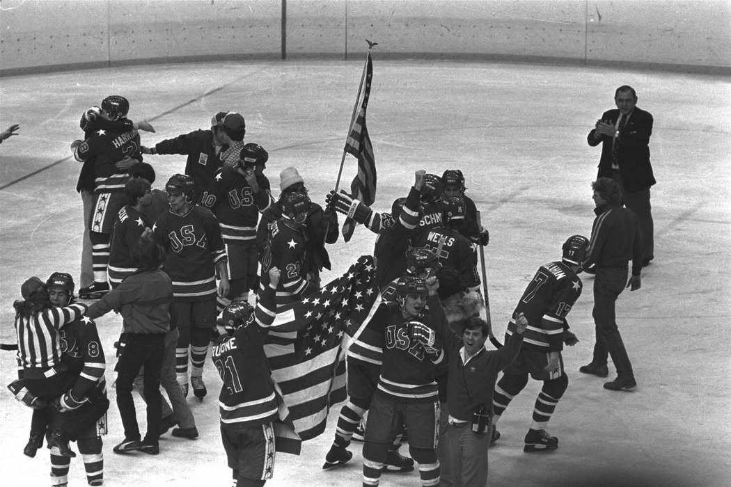 Members of the U.S. Olympic ice hockey team whoop it up on ice at the arena after winning the g ...