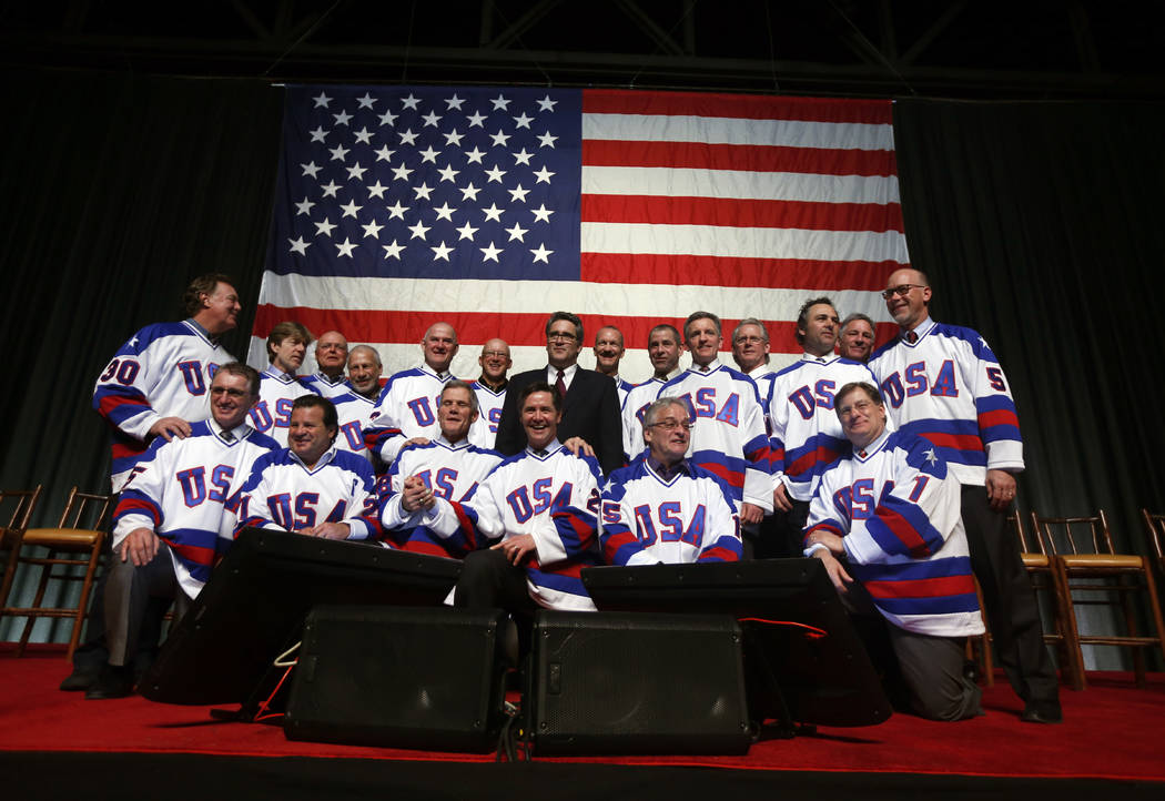 "Members of the 1980 U.S. ice hockey team pose for photos after a ""Relive the Miracle"" reunion a ..."