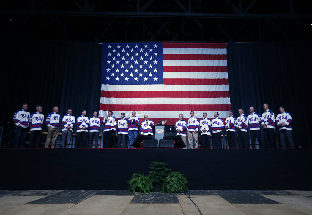 "Members of the 1980 U.S. ice hockey team stand on stage during a ""Relive the Miracle"" reunion a ..."