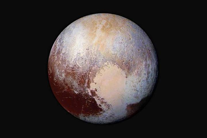 This 2015 image shows a combination of images captured by the New Horizons spacecraft with enha ...