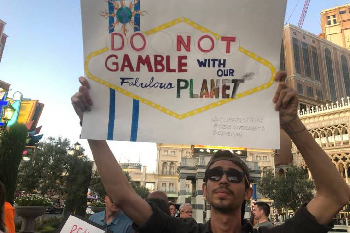 Katelyn Newberg/Las Vegas Review-Journal Israan Mendes, 24, holds a sign as more than 100 peopl ...