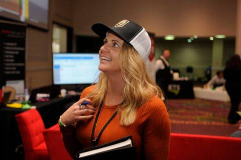 Ashley Taylor watches a race during the National Horseplayers Championship at Bally's Las Vegas ...