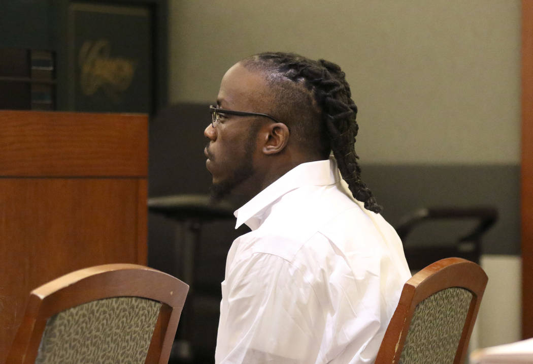 Durwin Allen, charged in the killings of Myron Manghum, 33, and Alyssa Velasco, 27, listens as ...