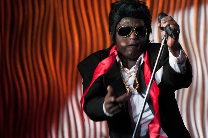 Sean E. Cooper performs an Elvis Presley impression during his show at Sin City Theatre inside ...
